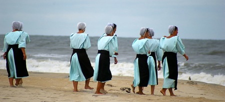 Amish women in modest swimwear at the beach. Photo by Pasteur.