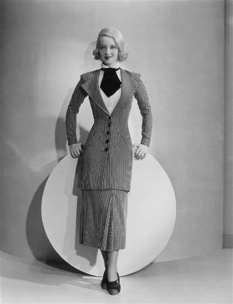 Bette Davis in checkered suit.
