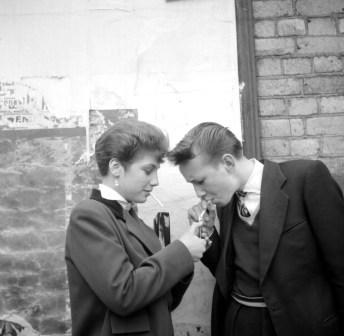 A Teddy Boy and a Teddy Girl, with cigarette and lighter. Photo by Ken Russell.