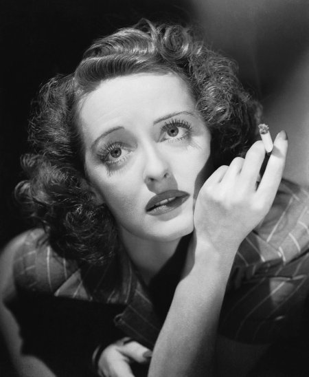 Bette with a cigarette.