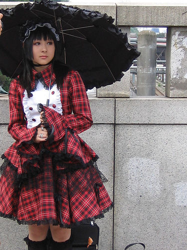 A Gothic Lolita in tartan. Photo by Jae Young Kim. CC Attribution License.