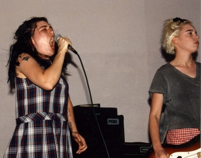 Two members of Bikini Kill