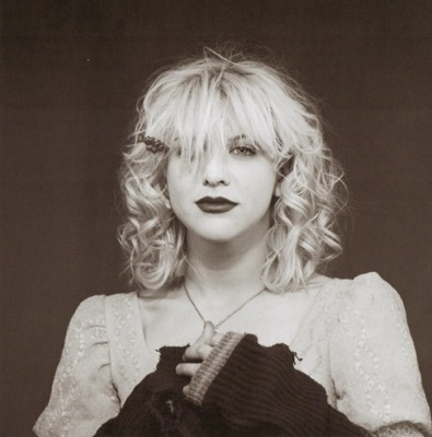 Courtney Love in a kinderwhore outfit.