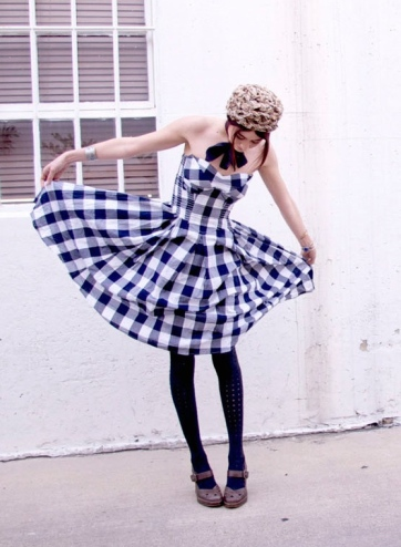 Megan Stewart in checkered dress.