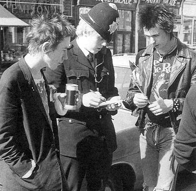 The Sex Pistols and a police officer: two types of uniform.