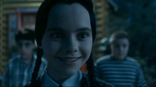 Wednesday Addams smiling.