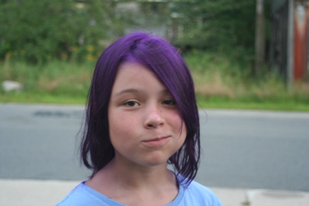 A young girl with purple hair. Photo by Kelly Taylor.