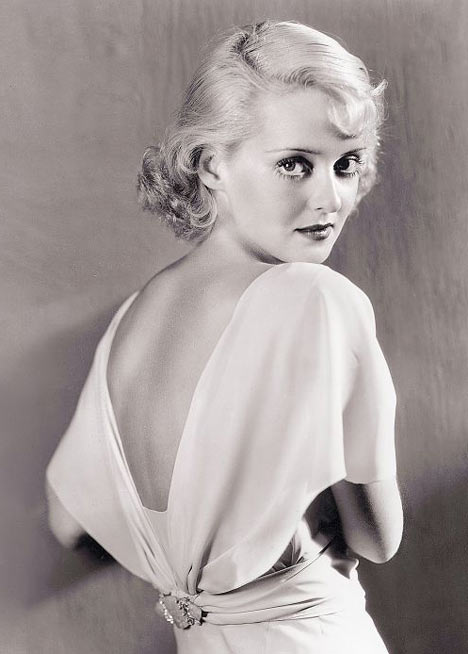 Bette Davis with blonde hair.