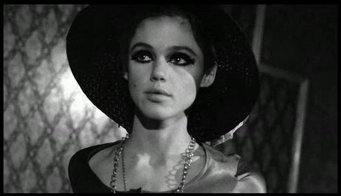 One classy dame...Edie Sedgwick in a black hat.