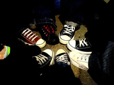 A circle of converse shoes. Photo by mickey van der stap.