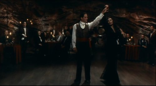 Morticia and Gomez Addams dancing.