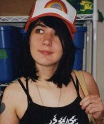 Kathleen Hanna with rainbow cap.
