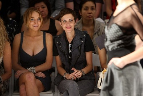 Lindsay Lohan and Samantha Ronson, watching the dress and the model, respectively.