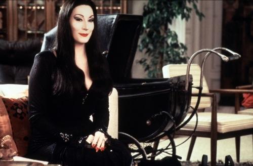 Anjelica Huston as Morticia Addams.
