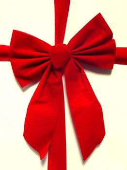 Red gift ribbon in bow.