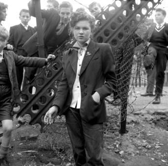 A Teddy Girl, with Teddy Boys in tow. Photo by Ken Russell.