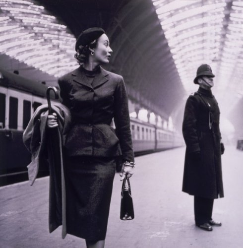 Fashion model at Victoria Station, in the 1950s.